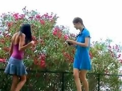 A duo girlfriends Beata and moreover Mia smoke me and moreover my large purple rod outdoors under trees