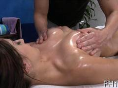Tattooed chick gets her hot breasts groped on a massage table