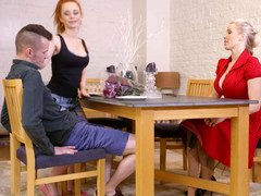 A milf gets under the table to suck a large hard dick