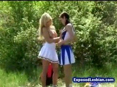 Lascivious breasty cheerleaders camping outdoors and also licking out each separate others honey pot