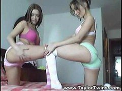 A couple of hot lesbo twins perform sexual gymnastics on queen-size bed
