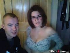 this brunette with glasses shows her sizeable boobs and sucks a purple pole feature