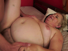 A porky and nasty granny is riding a fella on the bed and she is moaning