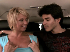 Pretty blonde soccer mom with sizeable fake breasts is getting groped and kissed