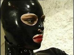 Hot cat dame in leather suit does anything she wants to her aroused slave