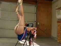 Cheerleader pegged down to chair