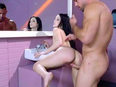 A boobalicious raven haired bitch is getting fucked in the bathroom