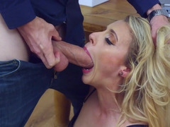 A blonde with curly hair is getting her vag penetrated by a long fuck pole