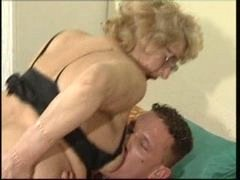 A blonde gran with glasses rides her hot youthful boy
