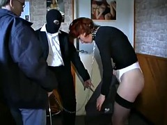 redhead mature's spanked by a guy wearing a ski masks