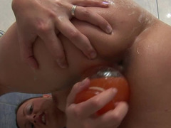 A woman takes a sexy bath by herself and she is showing her ass