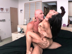 A brunette Latina that has natural boobs is getting her cunt rammed