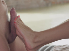 Slender beauty gets her feet worshiped by lover's dick