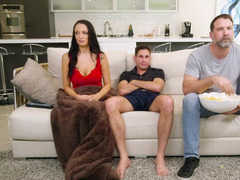 A hot slut is getting her pussy fucked behind her husband's back