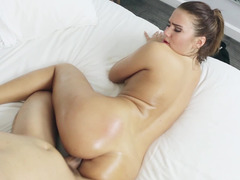 A brunette goes crazy while fucking doggy style on the bed