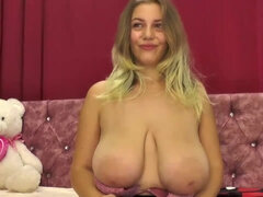 Busty blonde bares giant boobs on her webcam