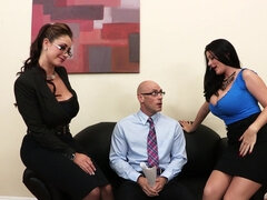 Two secretaries are pleasing their boss