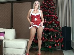Grown-up mom dressed in a sexy Christmas outfit