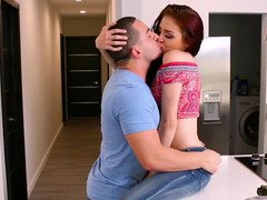 A redhead with small nipples is getting kissed and fucked too