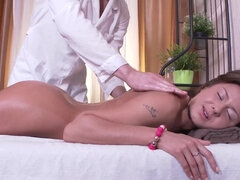 Jezla enjoys masseur's cock inside her laying on the massage table
