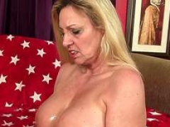Bigtitted Granny Cala Craves Gives an Oily Titjob and plus Gets Pummeled