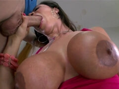 Sultry MILF with coconuts carefully polishes colleague's penis