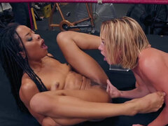 Gorgeous Carter Cruise and Kira Noir have lesbian sex in the ring in oil
