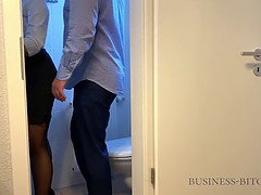 Boss meets secretary on the office restroom