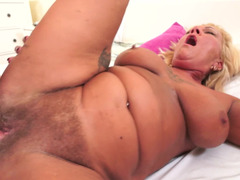 Nasty granny with a plump body is getting cum in her face