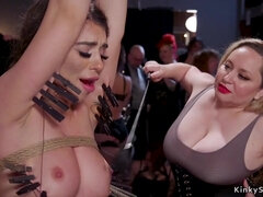 Brunette and ebony fucking at bdsm party