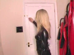 Latex dominatrix and victim in latex restrain bondage
