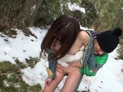 Japanese beauty gives a blowjob in the snowy woods