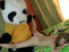 A man in a panda outfit is having his way with a young female