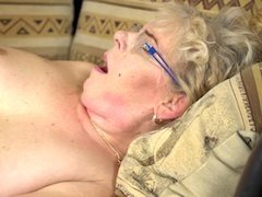Granny on her back with a young cock fucking her shaved cunt