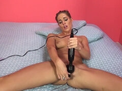 Horny chick is masturbating in her bed