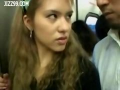 a couple of anthomaniac girls in train gives geek handjob