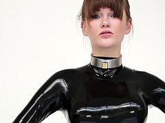 Model in spandex catsuit and ballet boots.