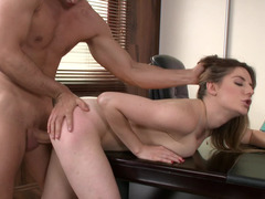 Brunette is getting penetrated in the office by the warden with a sizeable cock