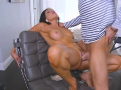 Big titted brunette is riding hard dick
