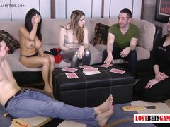 Teen girls and boys playing funny stripping game