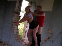 Amateur blonde whore gets nailed in an abandoned house by two guys