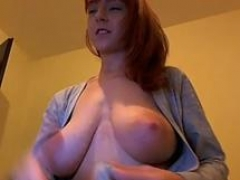 big-breasted natural redhead shaves her pussy front the online camera clip