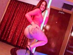 Stripper is dancing around the pole and is then giving bj