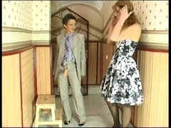 Lesbian in mans' suit Bridget is fucking milf with strapon
