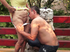 A granny is outdoors and besides she is getting fucked really hard