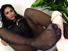 Domme Alexya in pantyhose gives you a footjob