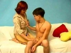 Young-looking slender boy with curvy old Russian woman