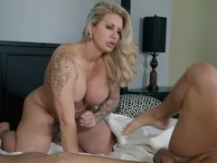 Tattooed blonde MILF seduces stepdaughter's boyfriend for sex
