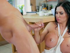 Big-breasted brunette is distracted from cooking by her BF