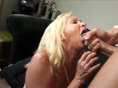 A blonde granny likes to taste huge hard penis in her wet pussy